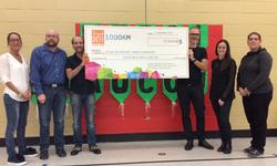 Lavery donates $12,910 raised during the Grand défi Pierre Lavoie to Versant Sainte-Geneviève school in Québec City